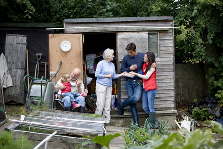 self sufficient: Family having a break on an allotment