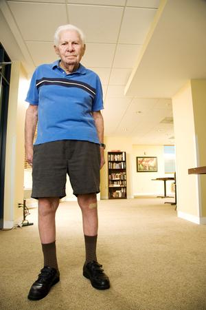 difficult lives: An elderly man wearing shorts