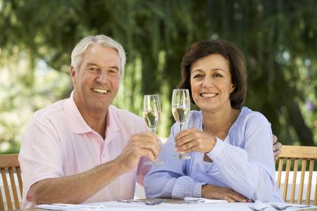 A senior couple celebrating