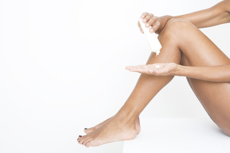 moisturiser: A woman applying moisturiser to her legs