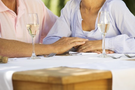 A senior couple celebrating close-up of hands and champagne flutes Stock fotó