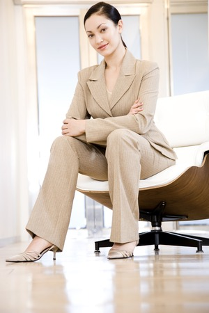 Portrait of a smiling businesswoman sitting in a modern chairn