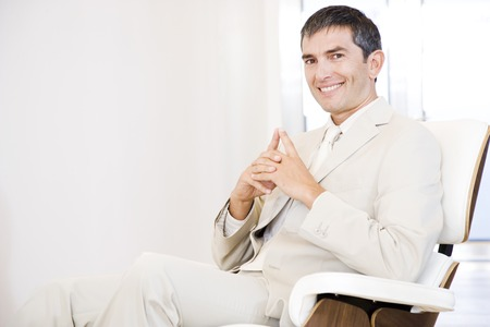 A businessman looking happy and relaxing in a chair Stock Photo