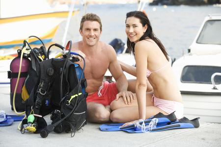 A couple checking their scuba diving equipment