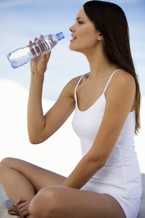 A woman drinking a bottle of water Stock Photo
