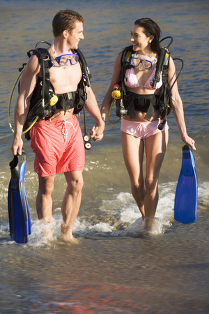 explored: A couple returning from scuba diving
