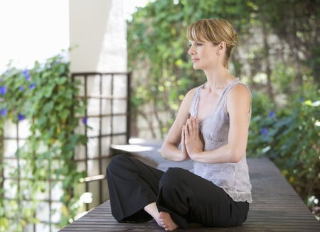 spiritual beings: A young woman meditating