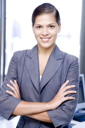 arms folded: Businesswoman smiling with her arms folded, portrait