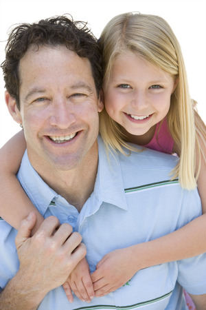Cut out of loving smiling daughter hugging father at camera