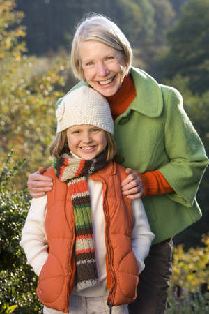 Portrait of grandmother with granddaughter in autumn countryside Stock Photo