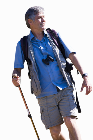 Cut out of active mature man hiking carrying pole