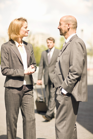 Businessman and businesswoman meeting having discussion in street Stok Fotoğraf