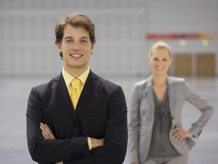 Businessman and businesswoman in open plan conference center space Reklamní fotografie