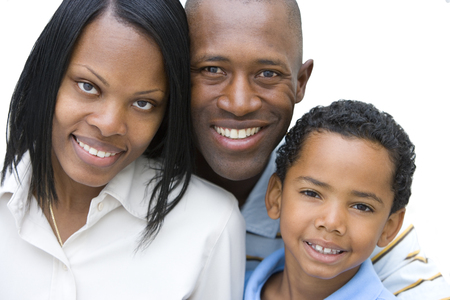 Cut out of smiling family with one son at camera on white background