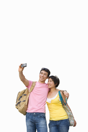 Cut out of smiling tourist couple taking selfie on camera