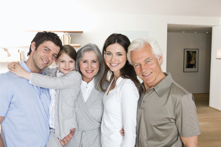 Portrait of smiling multi-generation family at home together