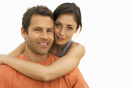 Cut out of loving young couple hugging at camera
