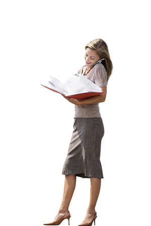 Cut out of businesswoman talking on mobile phone reading file Stock Photo - 119610556