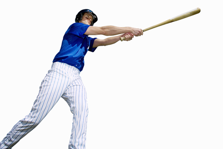 Cut out of american baseball player with bat hitting ball