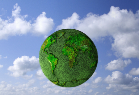 Environmental concept with world map imposed on grass covered globe Banco de Imagens