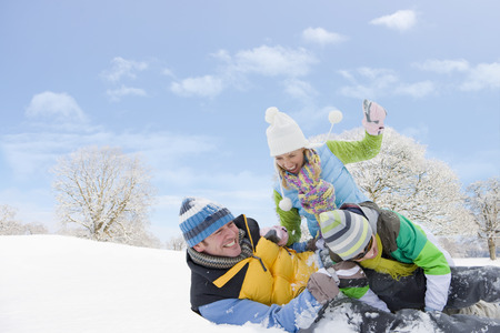 Family having fun playing in snowy landscape together