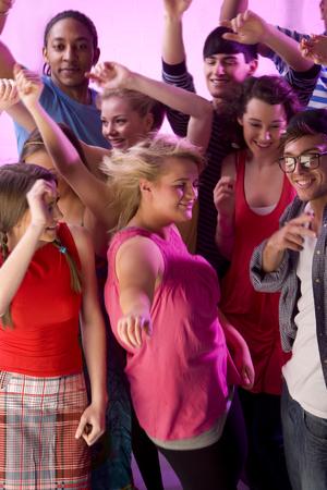 Group of friends at nightclub dancing