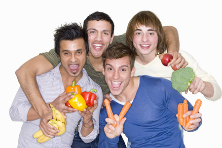 Men holding fresh fruit and vegetables