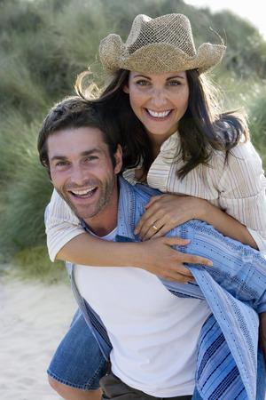 Portrait of man piggybacking woman Stock Photo