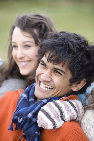 Teenage girl and young man smiling