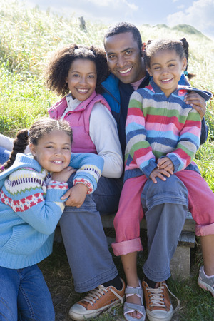 Portrait of family sitting on grass Stock Photo
