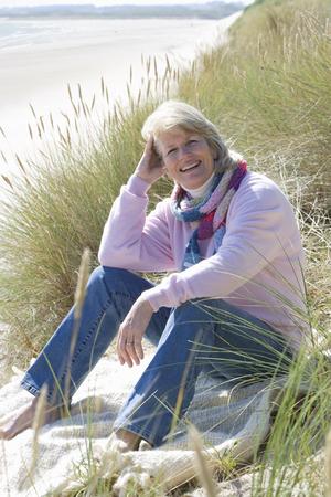 Portrait of mature woman sitting on beach