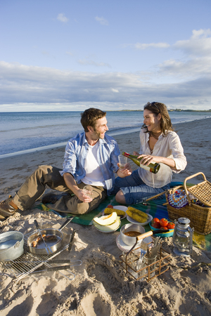 Couple having drinks on beach