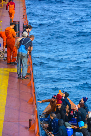 fled: Napoli - Italy - Circe january 2016: Napolis 100 nm open while I was cruising with the cargo ship, we met with refugees who fled to Algeria, we took them to the ship and handed to the coast guard
