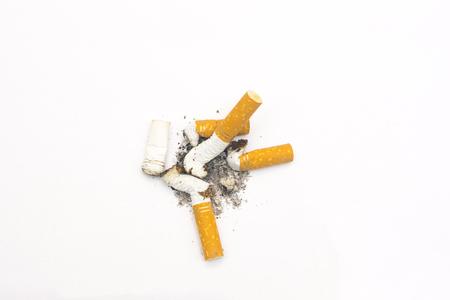 分離の白い背景の上のタバコの吸殻を合成写真を閉じる 写真素材