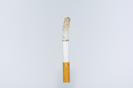burning cigarette on isolated white background composition photography