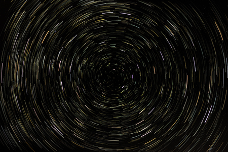 colored star trails on isolated black background composition photography 写真素材