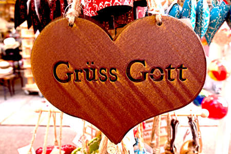 Closeup of a felt heart souvenir. The typical German greeting ? ?? Grüss Got?? is carved in the felt. ? ?? Grüss Got?? means ? ?? May God bless you?? , and is a common greeting in Southern Germany, and Austria.