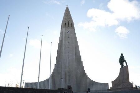 facade of Hallgrimskirkja church in Reykjavik with statue of Leif Erikson