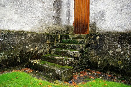 Mossy steps at the church in St. Cyran du Jambot