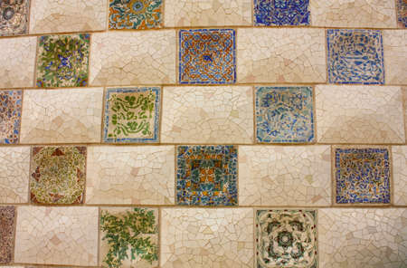 Gaudi Mosaic. Detail of a wall in the park  garden Parc Guell in Barcelona. photo