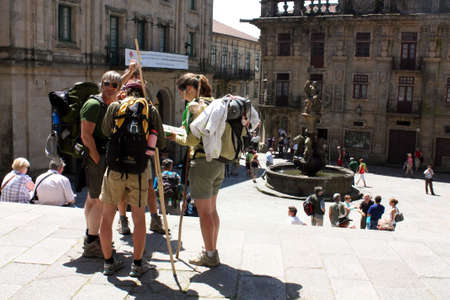 Santiago de Compostela. May 31th, 2009. Pilgrims on the Camino de Santiago in Platerías square, after arriving in Santiago de Compostela.2010 is a Jacobean Holy Year. Spain