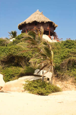 bikini construction: Hut with hammocks on a Caribbean beach. Tayrona National Park. Colombia.