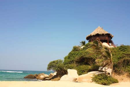 Hut with hammocks on a Caribbean beach. Tayrona National Park. Colombia. photo