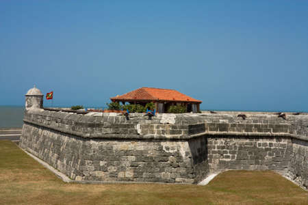 Colonial Wall of Cartagena de Indias. Colombia. Wall of the old city. The walls were designed in order to protect the Cartagena suffering ongoing attacks. Its construction was carried out in stages, beginning in 1586 and ending in 1721