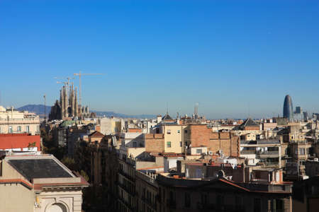 The Temple of La Sagrada Familia and other buildings and skyscrapers of Barcelona. Photo background. photo