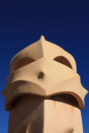 modernist: La Pedrera, Barcelona. Gaud�. On the terrace of the Casa Mila (also called La Pedrera) is a cross-shaped chimneys and soldiers of anthropomorphic forms created by Antonio Gaudi. It was created in 1905. Photo background.