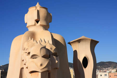 La Pedrera, Barcelona. Gaudí. On the terrace of the Casa Mila (also called La Pedrera) is a cross-shaped chimneys and soldiers of anthropomorphic forms created by Antonio Gaudi. It was created in 1905. Photo background. photo