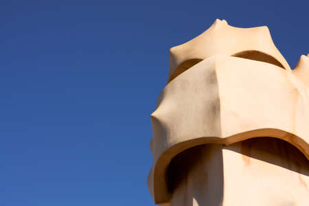 Barcelona & Gaudi. On the terrace of the Casa Mila (also called La Pedrera) is a cross-shaped chimneys and soldiers of anthropomorphic forms created by Antonio Gaudi. It was created in 1905. Photo background. Stock Photo - 6606626