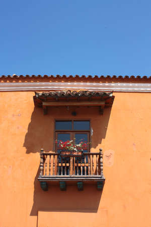 Detail of a colonial house. Typical balcony. Spanish colonial home. Cartagena de Indias, Colombia..In 1984, Cartagenas colonial walled city and fortress were designated a UNESCO World Heritage Site. photo