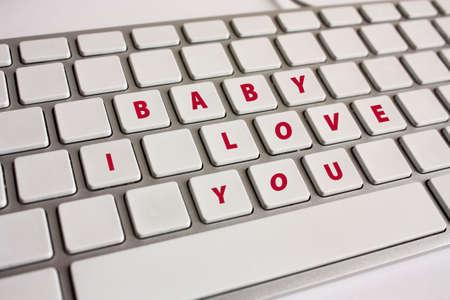 truelove: Baby, I love you. Romantic message written on a keyboard